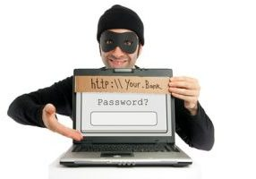 "A thief (dressed in black and eye-masked) pops up from behind a laptop's screen and hides the real URL by planting a fake one on it, clumsily written on a piece of cardboard as a visual metaphore for the phishing technique. Then, he ""kindly"" invites the user to fill in his/her bank account's password."